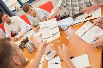 Photo: employees share information