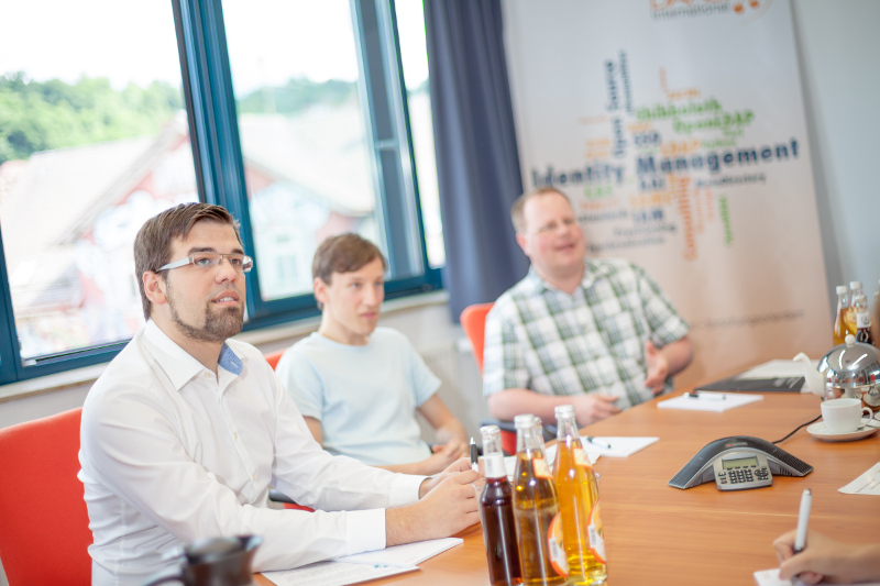 Das DAASI-Team in einem Meeting.