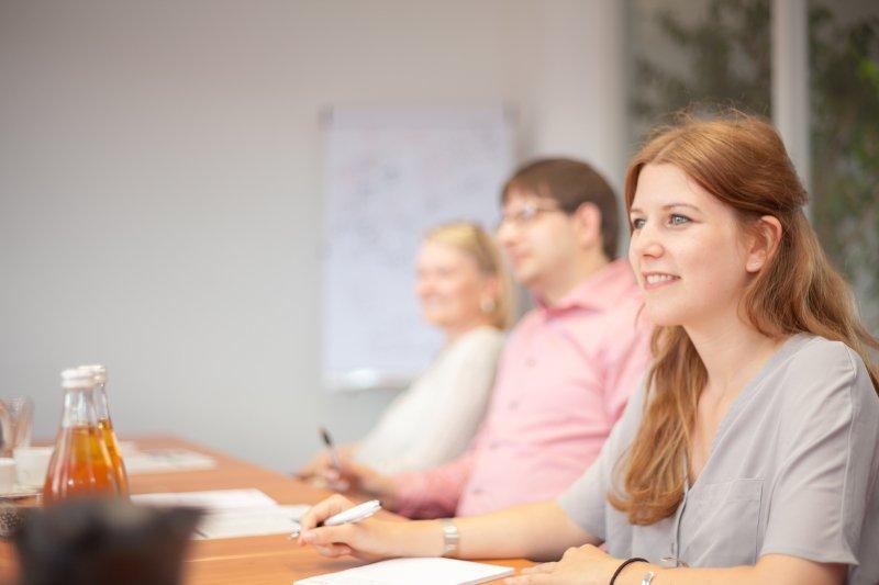 Photo: employee listening to a customer
