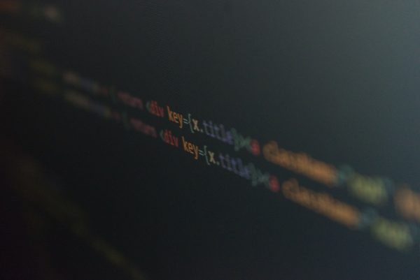Snipped source code (decorative) by Thomas Tasted @Unsplash
